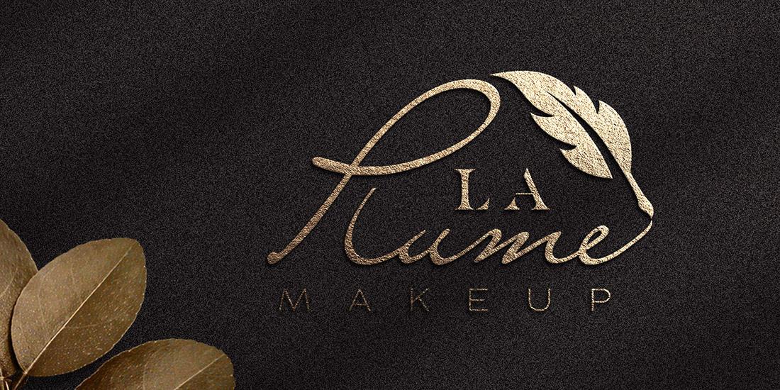 logo firmy kosmetycznej z piórem